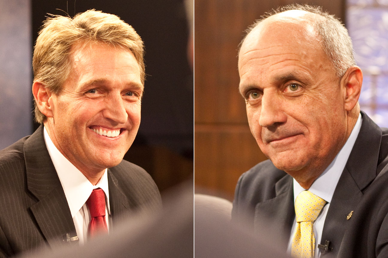 U.S. Rep. Jeff Flake (left) and former Surgeon General Richard Carmona square off at their first debate Wednesday. (Photo by Evan Wyloge/Arizona Capitol Times)