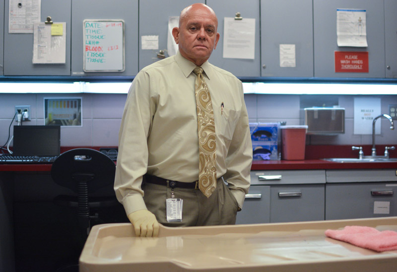 Clark County Coroner Michael Murphy stands in one of the receiving rooms of his office on July 2, 2014. Photo by Jacob Byk/News21.
