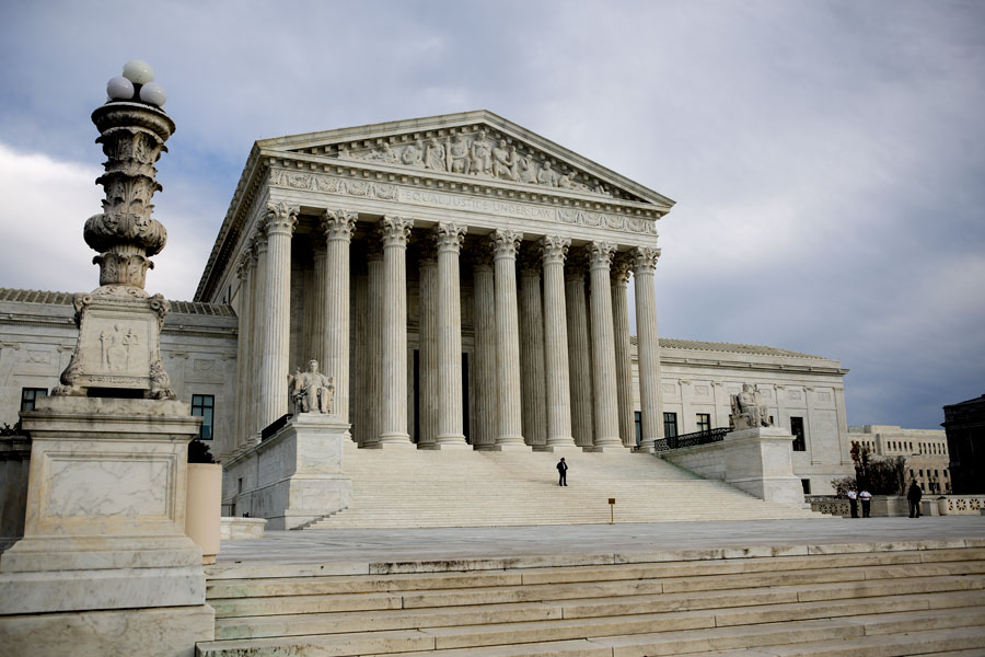A lone security guard stands watch outside the steps of the U.S. Supreme Court in Washington, D.C., on Monday, Dec. 7, 2015. The court today heard oral arguments in a challenge to Arizon's legislative districts, weighing whether the state's redistricting commission illegally diluted the voting power of nearly two million Arizonans. Photo by Evan Wyloge/AZCIR