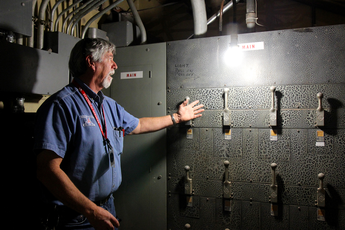 University of Arizona Facilities Management Electrician Joe Thomasson with the electrical panel underneath the Arizona State Museum on Wednesday, May 17, 2017. The electrical panel is an original system from when the museum was built in 1924. (Photograph by Julianne Stanford/AZCIR)